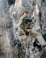 macgyver scaling a mountain