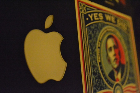 An Obama campaign decal next to the Apple logo on a user's laptop.