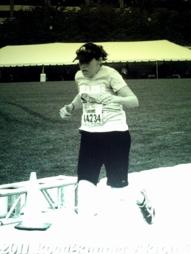 crossing the finish line of my first half-marathon
