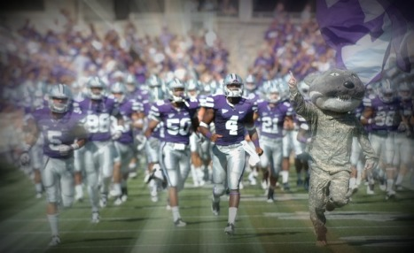 Wildcat Willie leads the Kansas State football team onto the field!