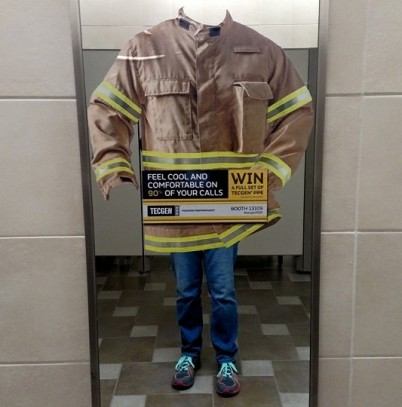 A turnout jacket cling on a bathroom mirror